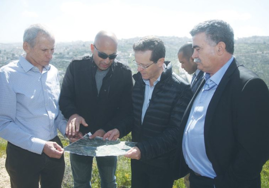 ZIONIST UNION head Isaac Herzog (second from right) and faction MKs Omer Bar-Lev (far left) and Amir