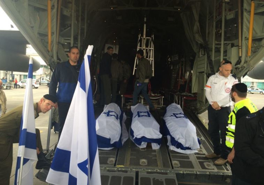The coffins of three Israelis killed in the Istanbul suicide bombing are loaded onto an IAF plane