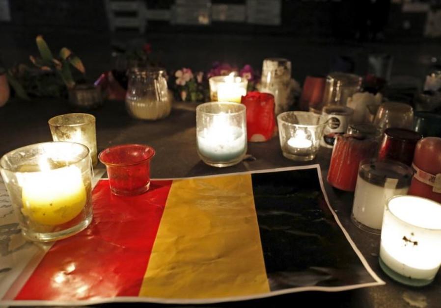 Candles are pictured around a Belgian flag on the Place de la Republique in Paris