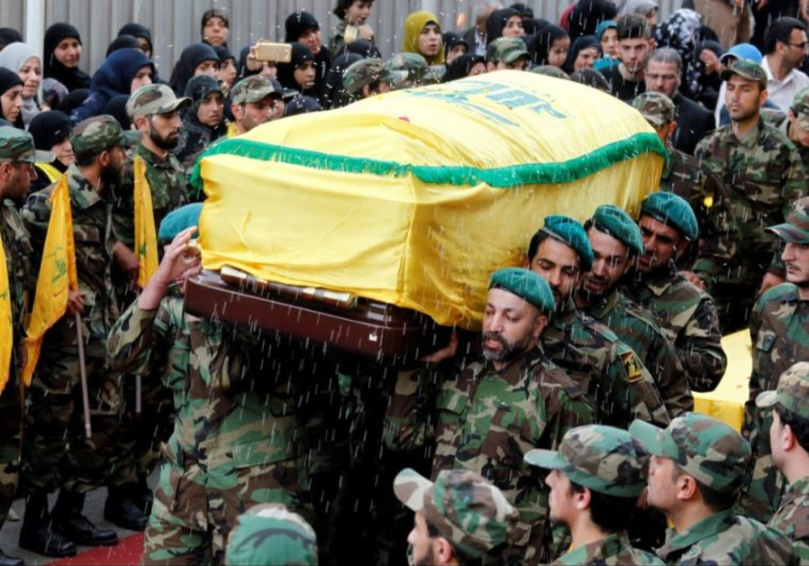 Rice is thrown as Hezbollah members carry the coffin of top Hezbollah commander Mustafa Badreddine