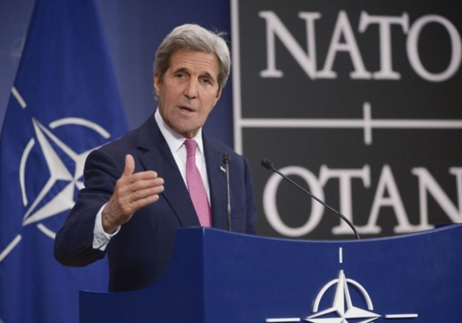 US Secretary of State John Kerry speaks to the press at NATO headquarters in Brussels