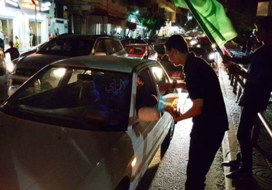 Youth in Tulkarm distributing candies