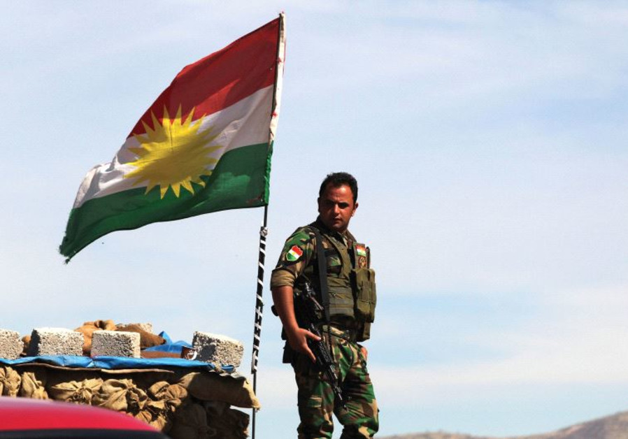 A KURDISH peshmerga soldier stands at a lookout near Bashiqa in northern Iraq