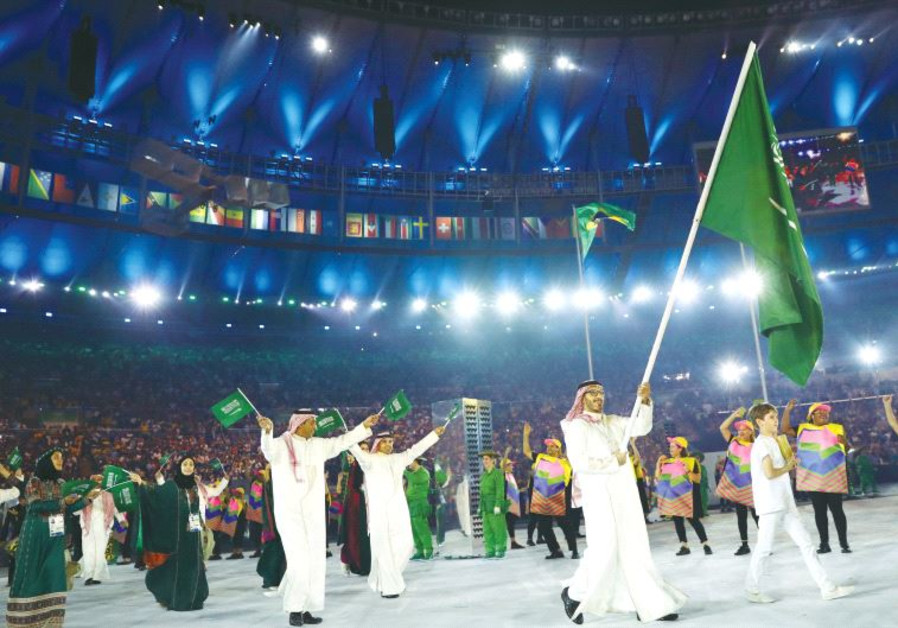 THE SAUDI ARABIAN delegation arrives at the Olympic opening ceremony in Brazil.