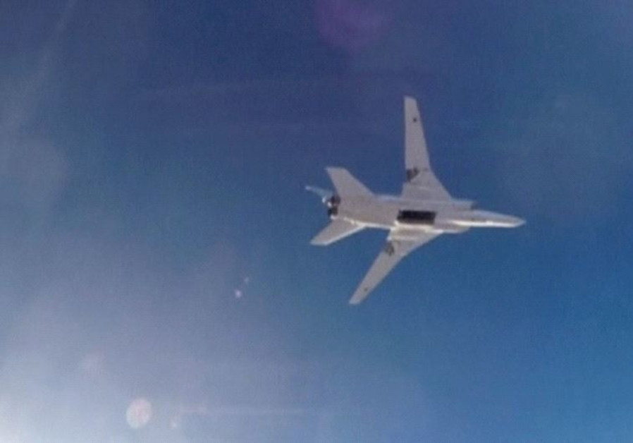 A STILL IMAGE taken from video shows a Russian Tupolev Tu-22M3 long-range bomber based in Iran flyin