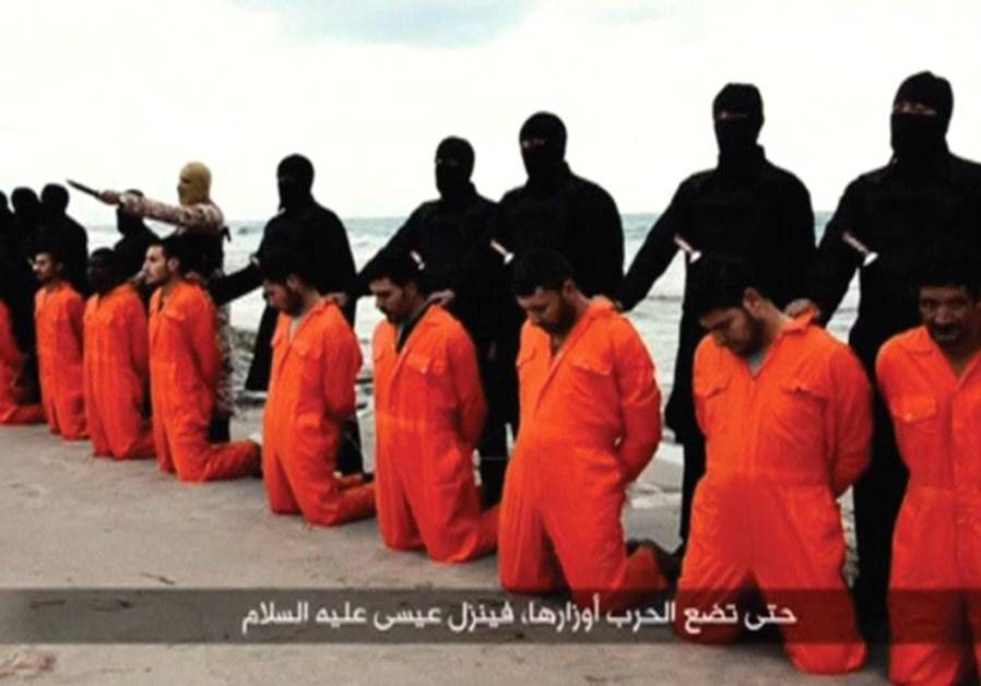 ISIS TERRORISTS pose on a Libyan beach in February 2015 with 21 captured Egyptian Christians they ar