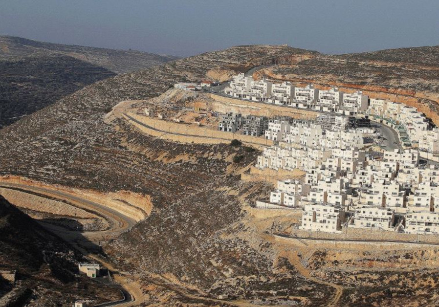 A CONSTRUCTION site in the West Bank settlement of Givat Ze'ev, near Jerusalem, in 2011