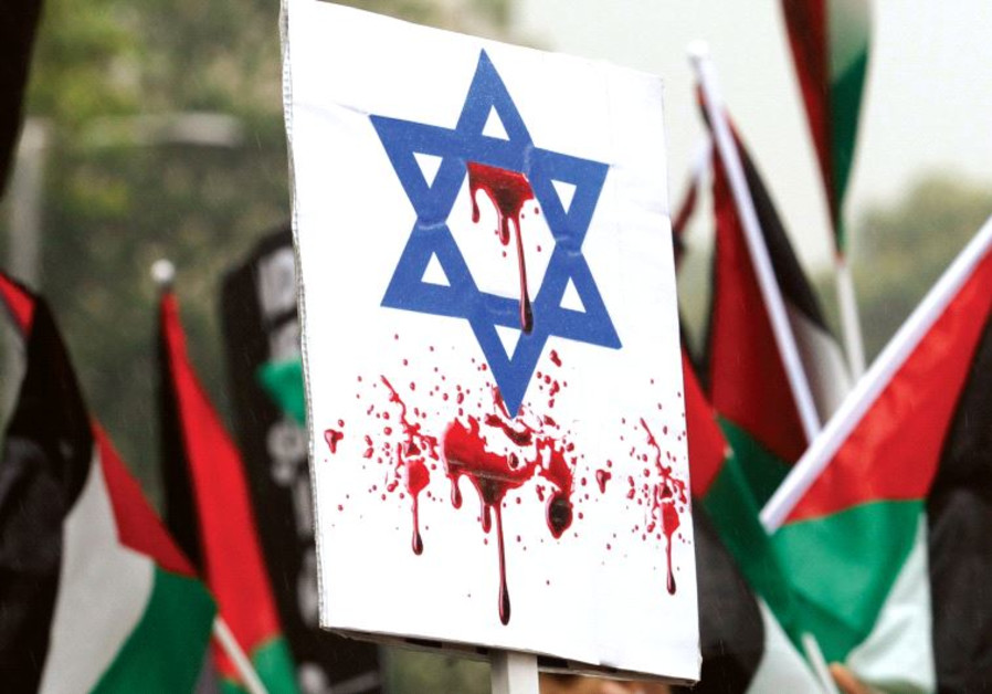 AN ISRAELI FLAG stained with fake blood at a pro-Palestinian rally in London.