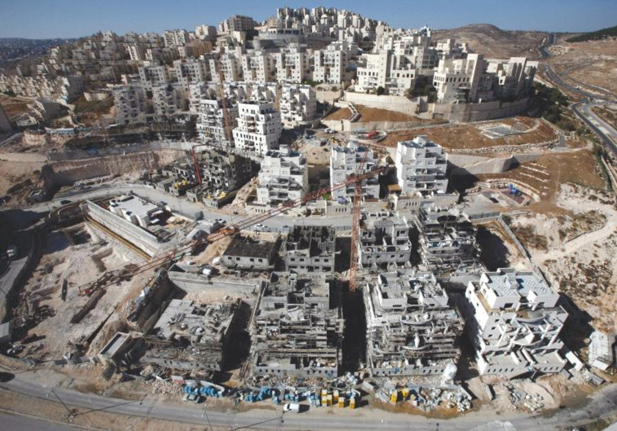 HOUSES UNDER construction in the Har Homa neighborhood of Jerusalem in 2010