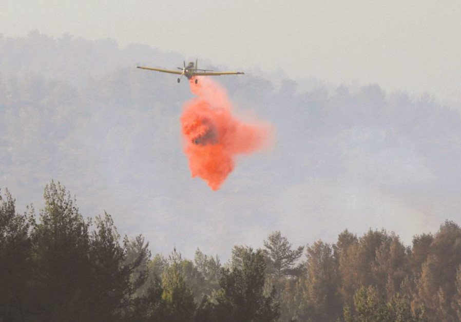A PLANE combats forest fires in the Jerusalem area last week