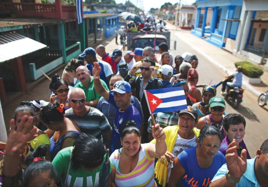 PEOPLE ARE transported to greet the caravan carrying the ashes of Fidel Castro in Colon, Cuba, on We
