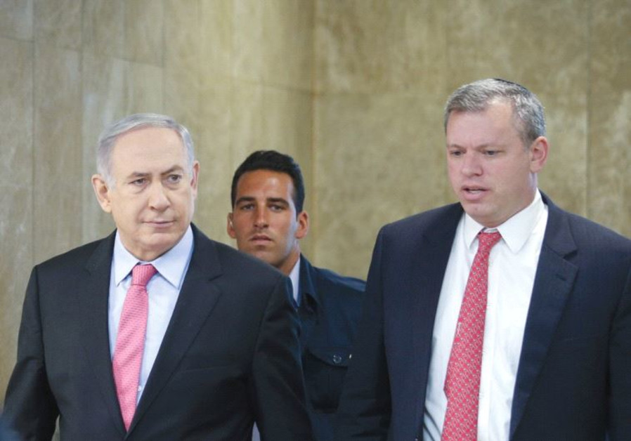 PRIME MINISTER Benjamin Netanyahu is accompanied by PMO Director-General Eli Groner to the weekly go