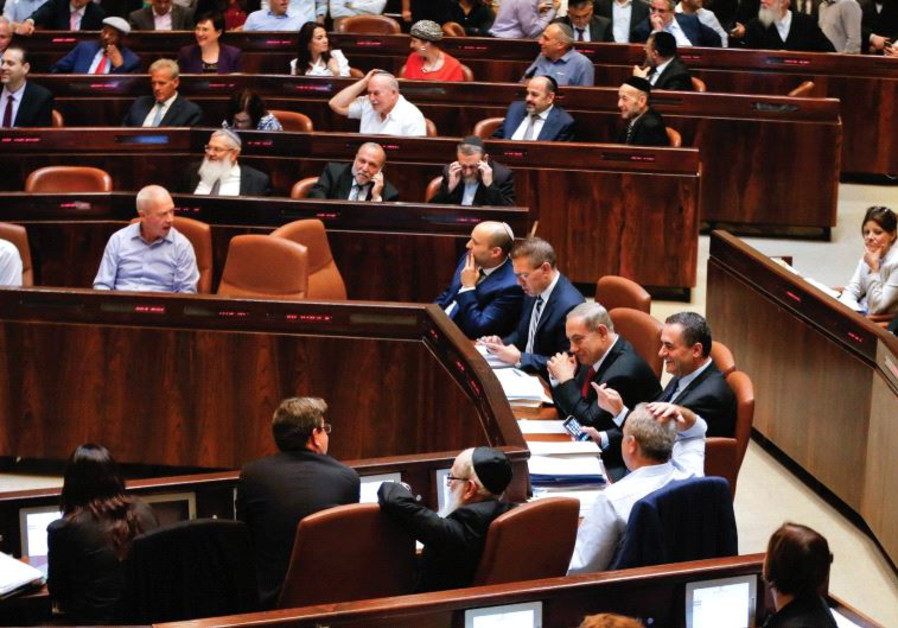 SHOW US the money. Lawmakers attend a preliminary vote on a bill at the Knesset