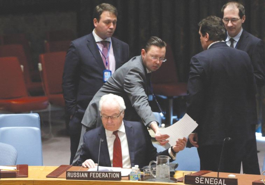 RUSSIA'S AMBASSADOR to the UN Vitaly Churkin sits in the security council chamber following a United