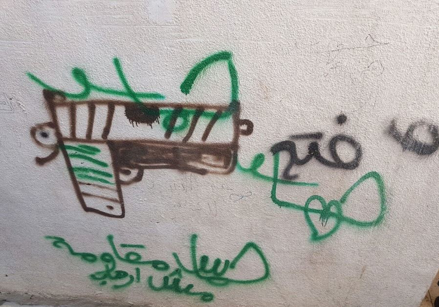 An image of the graffiti praising the terrorist in Sunday's attack.