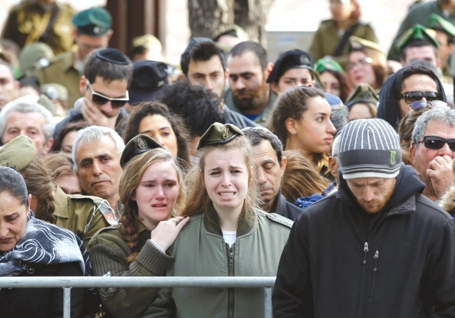 RELATIVES AND FRIENDS mourn during the funeral of IDF soldier Lt. Yael Yekutiel, who was killed on S