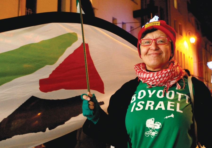 A WOMAN wearing a T-shirt that reads 'Boycott Israel' takes part in a pro-Palestinian demonstration