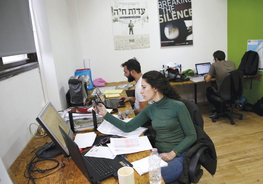 EMPLOYEES WORK at the offices of the Breaking the Silence NGO in Tel Aviv in 2015
