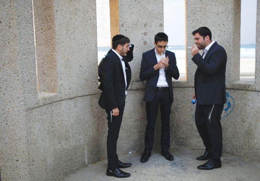 Young men smoking near Ashdod
