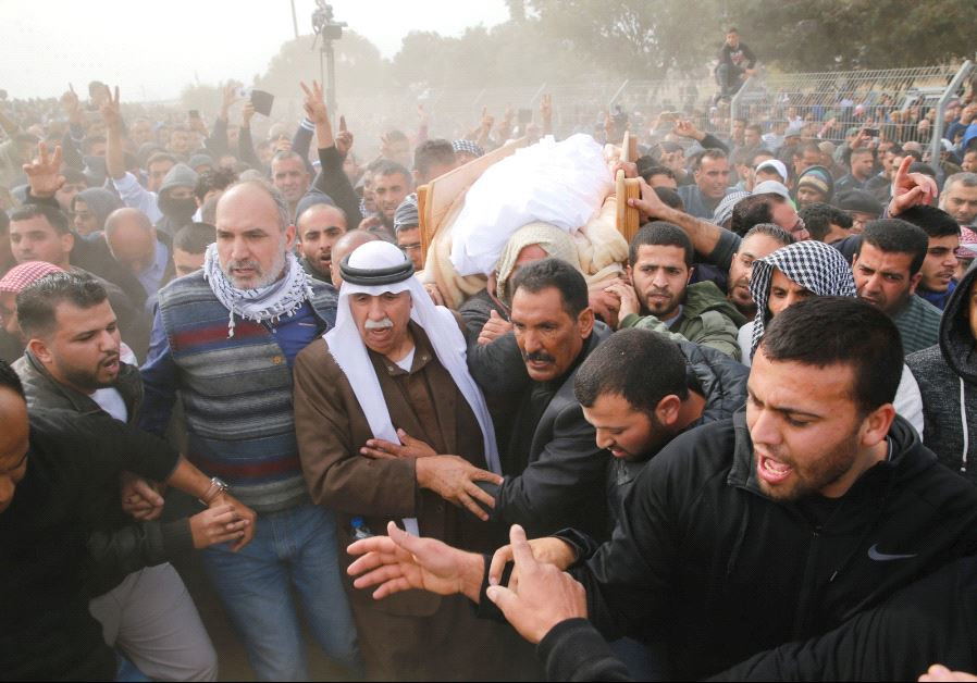 FRIENDS AND RELATIVES carry the body of Yacoub Abu al-Kiyan during his funeral.