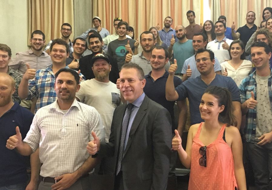 A GROUP of IDF reservists pose yesterday with Public Security and Strategic Affairs Minister Gilad E