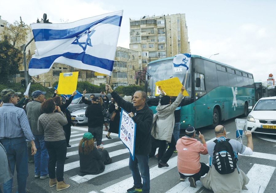 ISRAEL BROADCASTING AUTHORITY employees block the street during a protest against the Histadrut labo