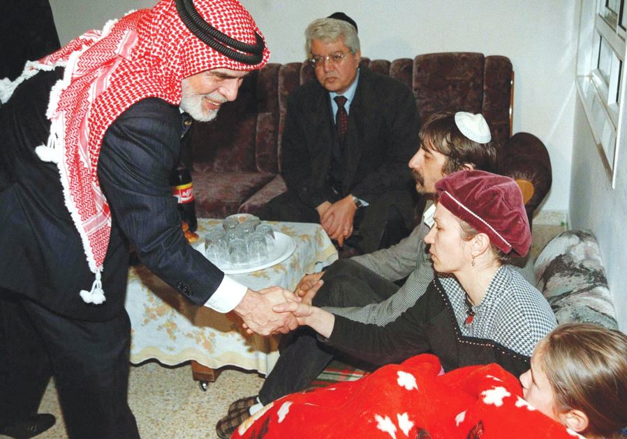 JORDAN'S KING Hussein leans over and shakes hands with Margalit Badayev, the mother of slain Israel