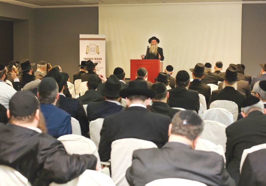 PARTICIPANTS AT THE Rabbinical Center of Europe conference listen as to a speaker address the organi