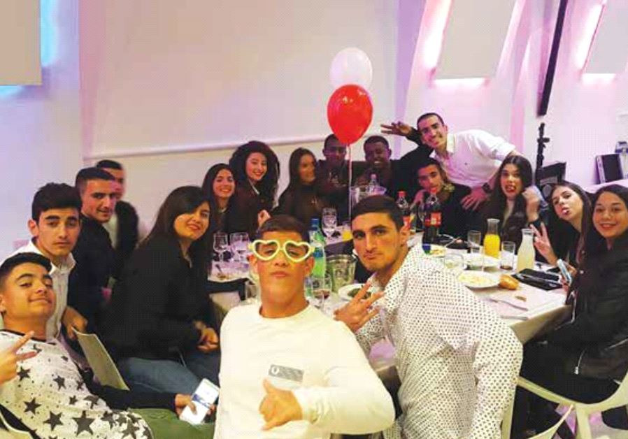 Ma'agalim volunteers pose at a bar mitzvah they organized in February as part of the organization's