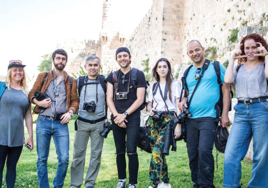 THE GROUP of photographers and their guides pose for a photo outside the Old City of Jerusalem yeste