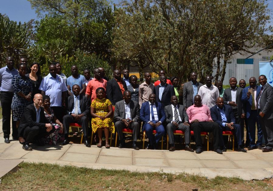A group photo with mayors and directors of city councils from Kenya and Uganda