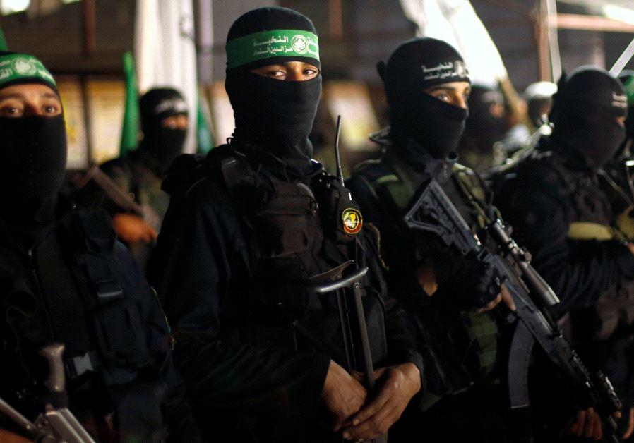 Palestinian Hamas militants take part in a memorial service for senior militant Mazen Fuqaha, in Gaz