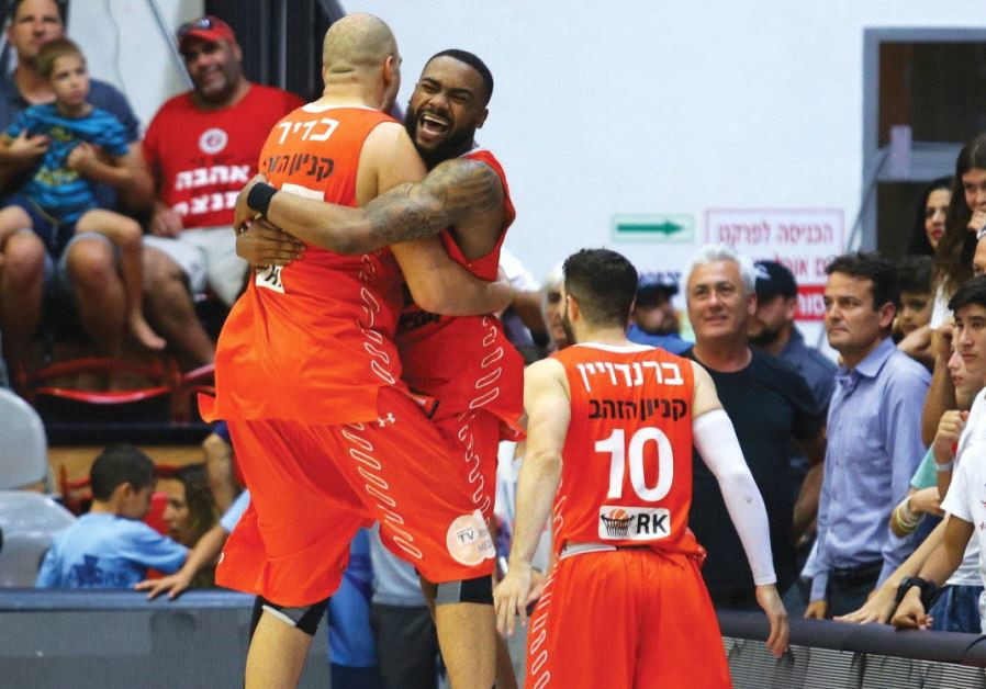 Maccabi Rishon Lezion forward Elishay Kadir (left) celebrates with teammate J.J. Moore after last ni