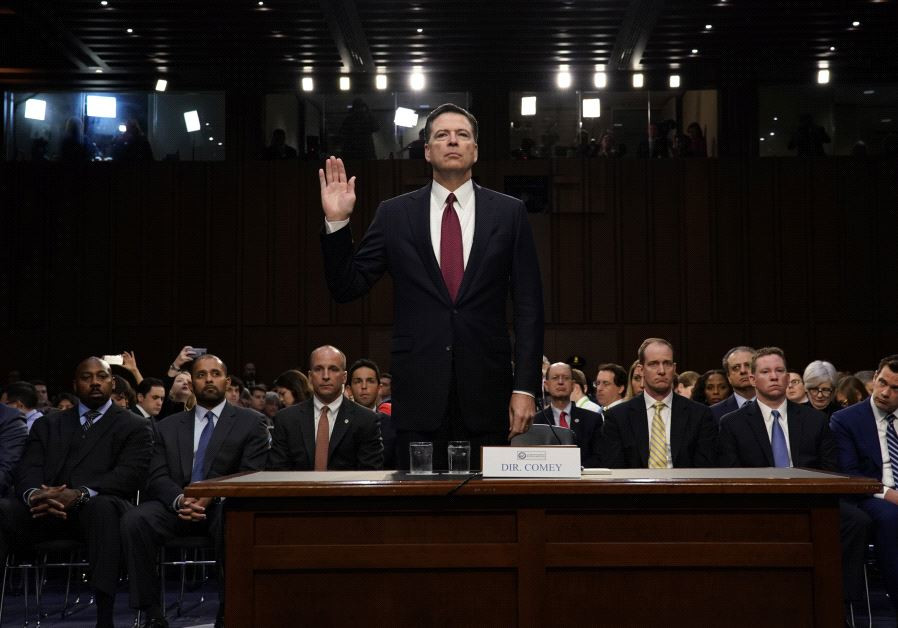Former FBI Director James Comey is sworn in prior to testifying before a Senate Intelligence Committ