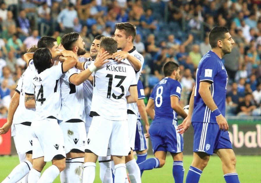 Albania pla yers celebrate their team's opener in last night's 3-0 victory over Israel in Haifa, wit