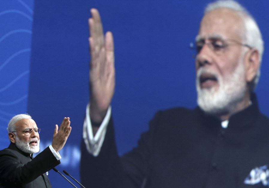 Indian Prime Minister Narendra Modi delivers a speech during a session of the St. Petersburg Interna