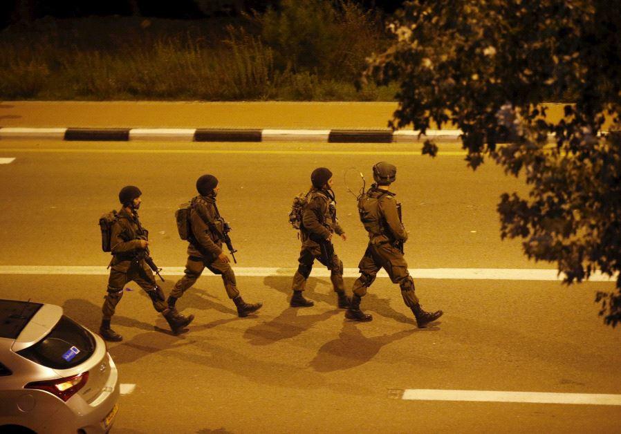 Israeli soldiers patrol near the scene of a Palestinian attack close to Alon Shvut, November 19 2015
