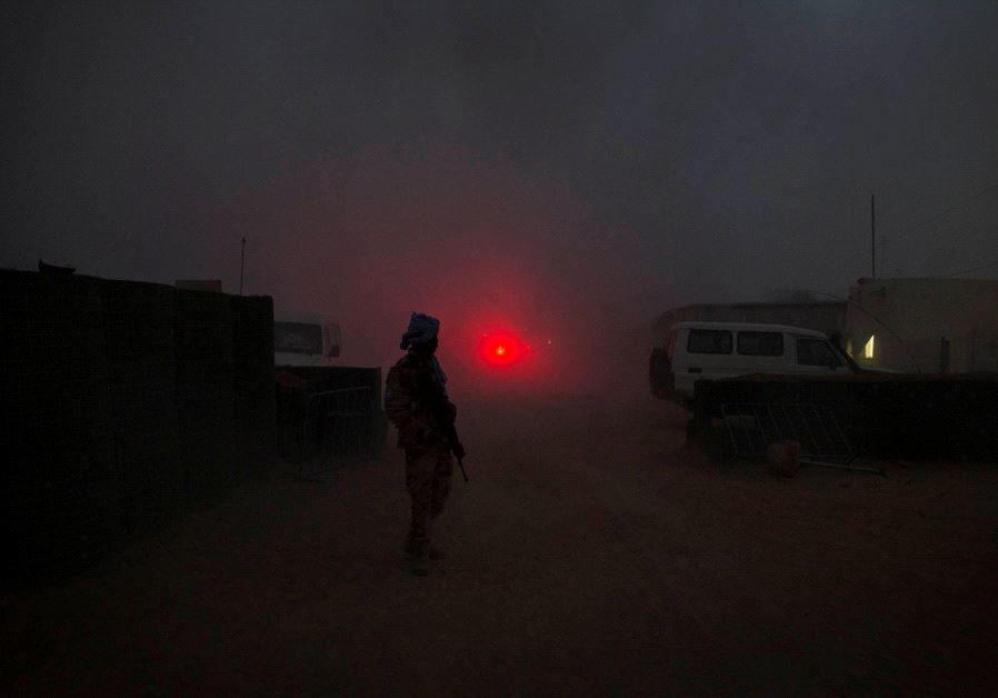 A UN peacekeeper secures the MINUSMA base after a mortar attack in June 2017