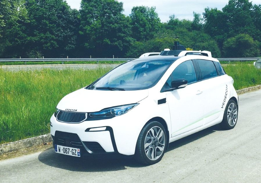 VEDECOM'S AUTONOMOUS VEHICLE is designed to detect ground markings, recognize signs and adjust speed