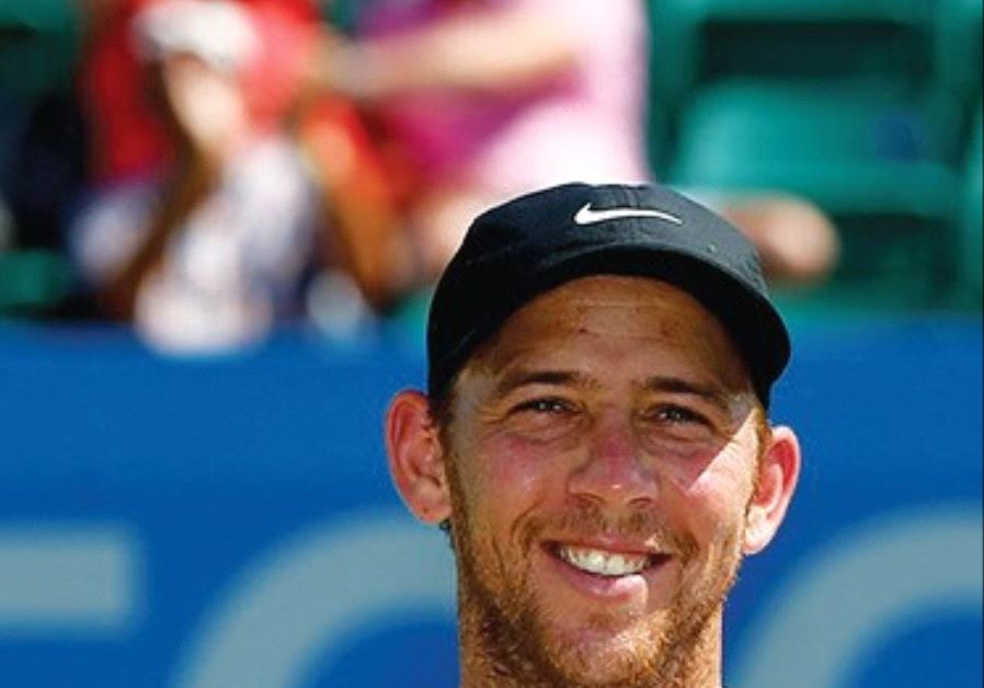 Dudi Sela poses with his trophy yesterday after winning the ATP Challenger Tour title in Nottingham,