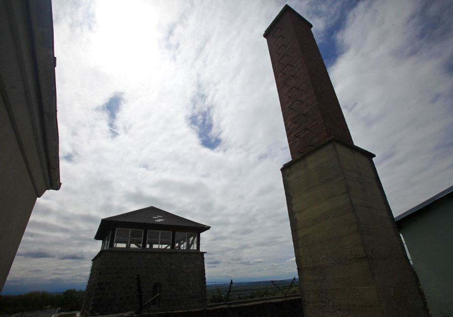 A view of the watch tower and a chimney of the former Austrian Nazi concentration camp in Mauthausen