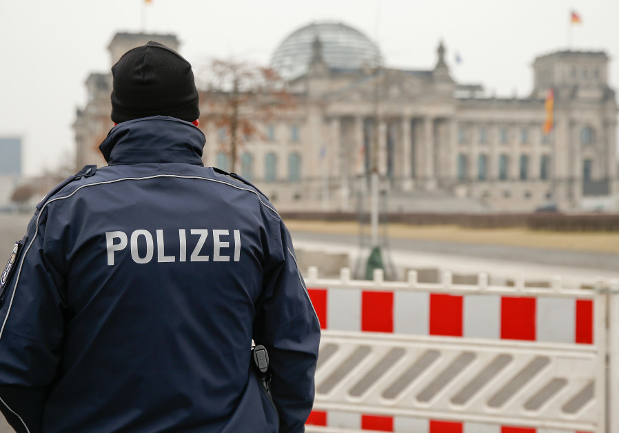 Chinese men held for allegedly doing Nazi salute by German parliament