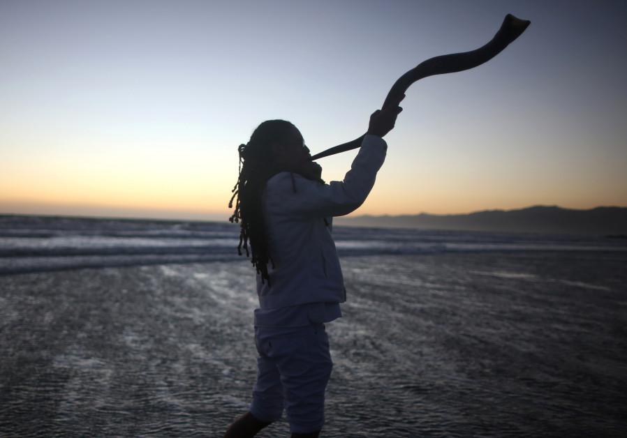 A young man plays the shofar during the Nashuva Spiritual Community Jewish New Year celebration