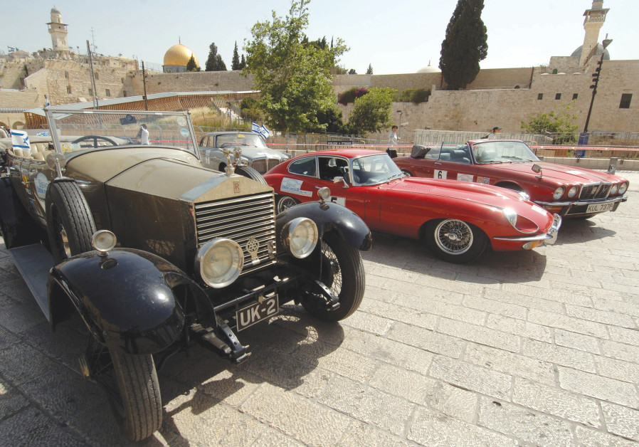 Vintage vehicles are parked near the Western Wall during a London-to- Jerusalem car rally raising