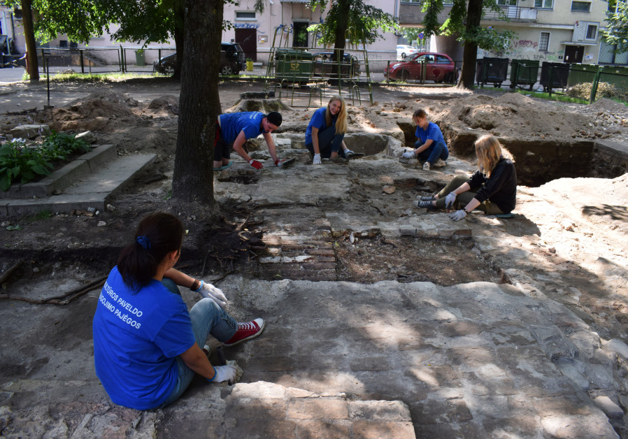 Volunteers, students and archaeologists excavate two recently uncovered mikves once belonging to the