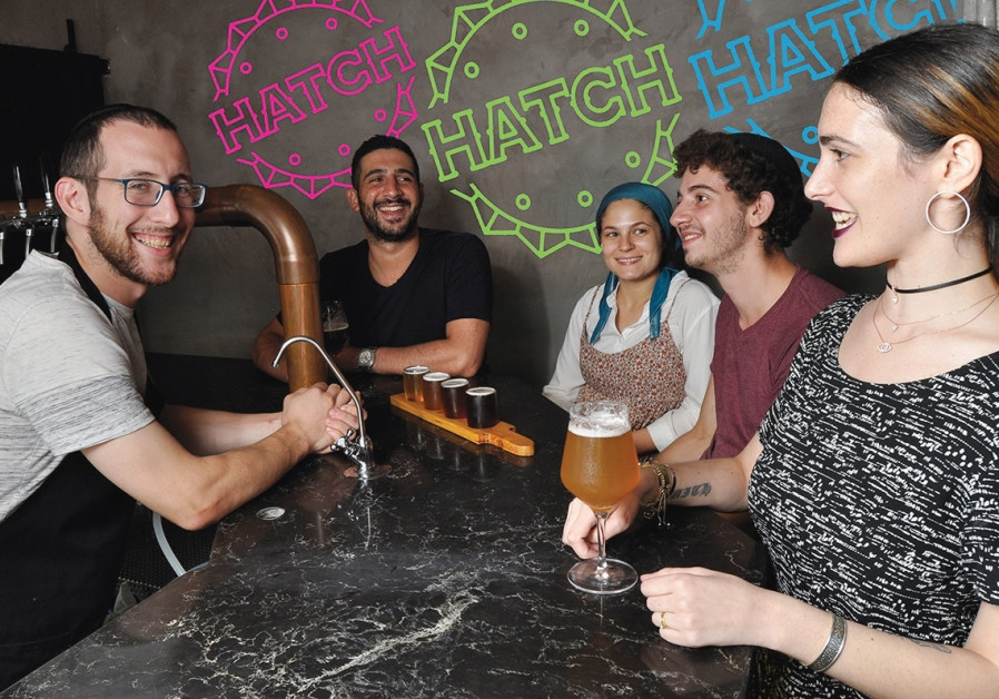 Ephraim Greenblatt (left) serves 'real food' and 'real beer' at Hatch. (