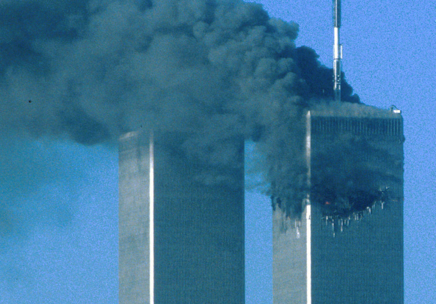 The twin towers after being hit, 9/11