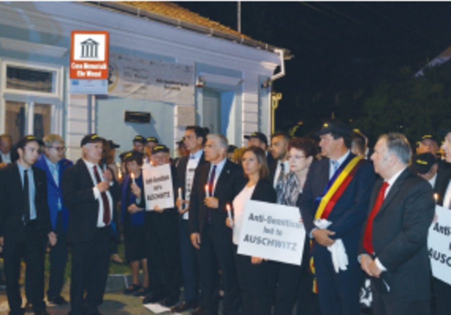 More than 1,500 people marched in memory of Elie Wiesel and Holocaust victims in Sighet, Romania