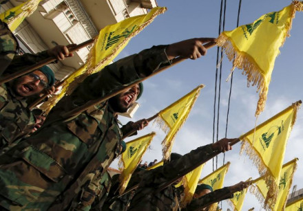 Lebanon's Hezbollah members carry Hezbollah flags during the funeral of Adnan Siblini