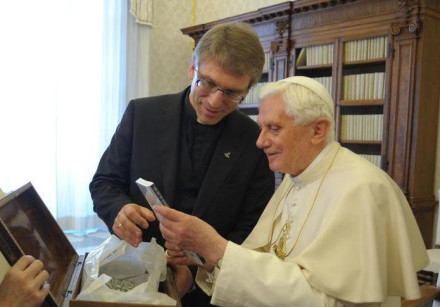 Pope Benedict XVI receives a book by Rev. Dr Olav Fykse Tveit, general-secretary of the WCC
